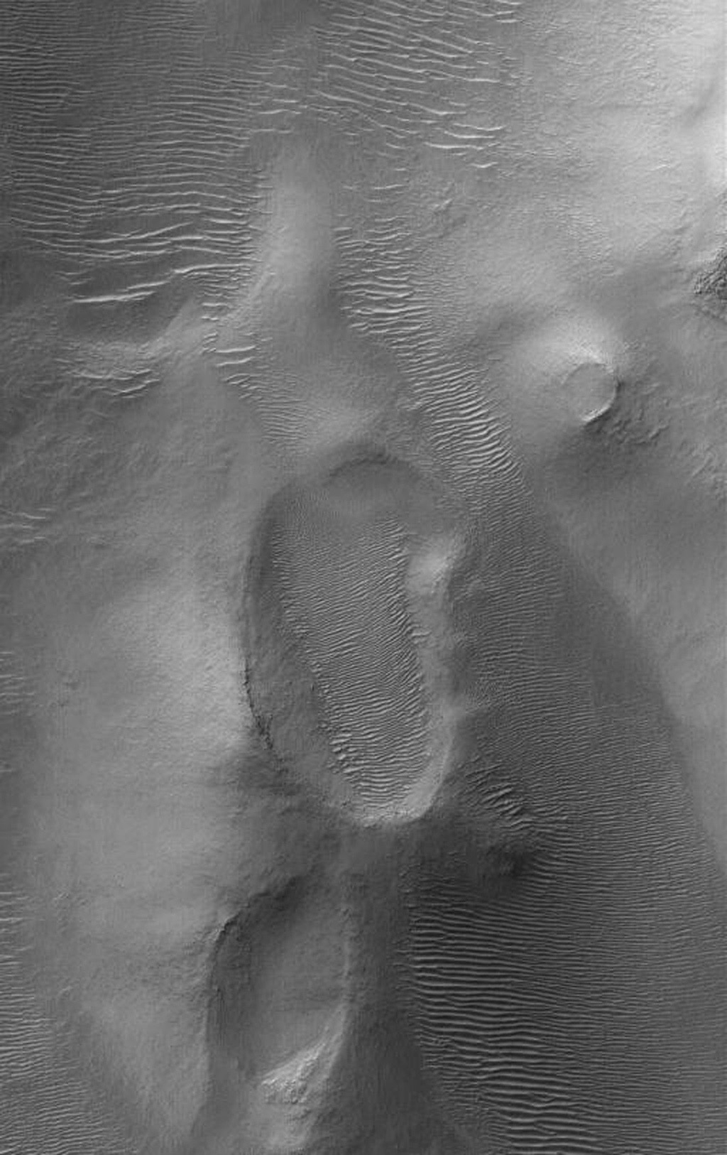NASA's Mars Global Surveyor shows landforms, including large, windblown ripples, on the floor of the ancient, giant Argyre impact basin on Mars.
