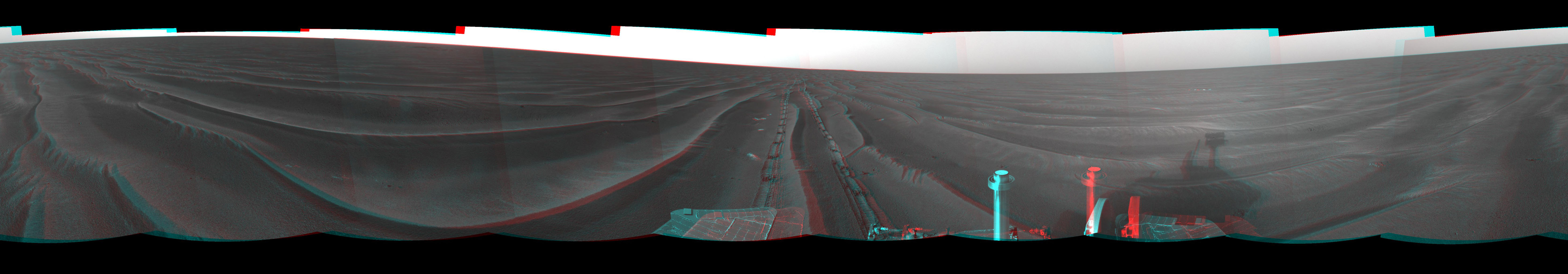 On Feb. 19, 2005, NASA's Mars Exploration Rover Opportunity set a one-day distance record for martian driving; Opportunity rolled 177.5 meters (582 feet) across the plain of Meridiani. 3-D glasses are necessary to view this image.