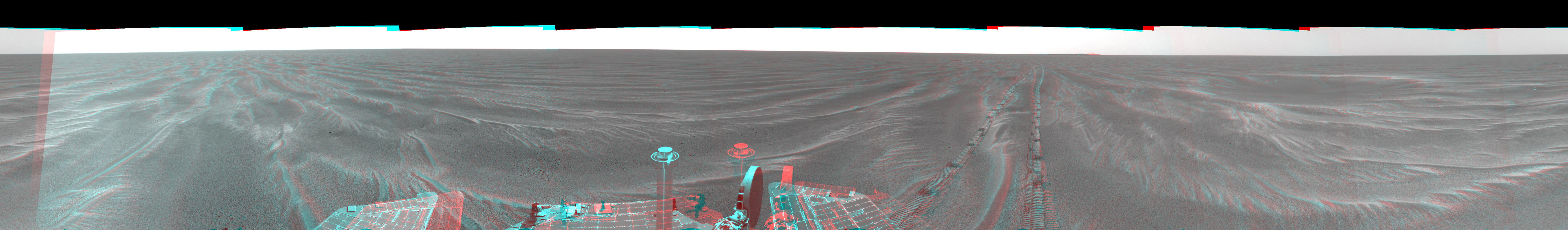 NASA's Mars Exploration Rover Opportunity arrived at this location close to a small crater dubbed 'Alvin' on Feb. 18 & 19, 2005. 3-D glasses are necessary to view this image.