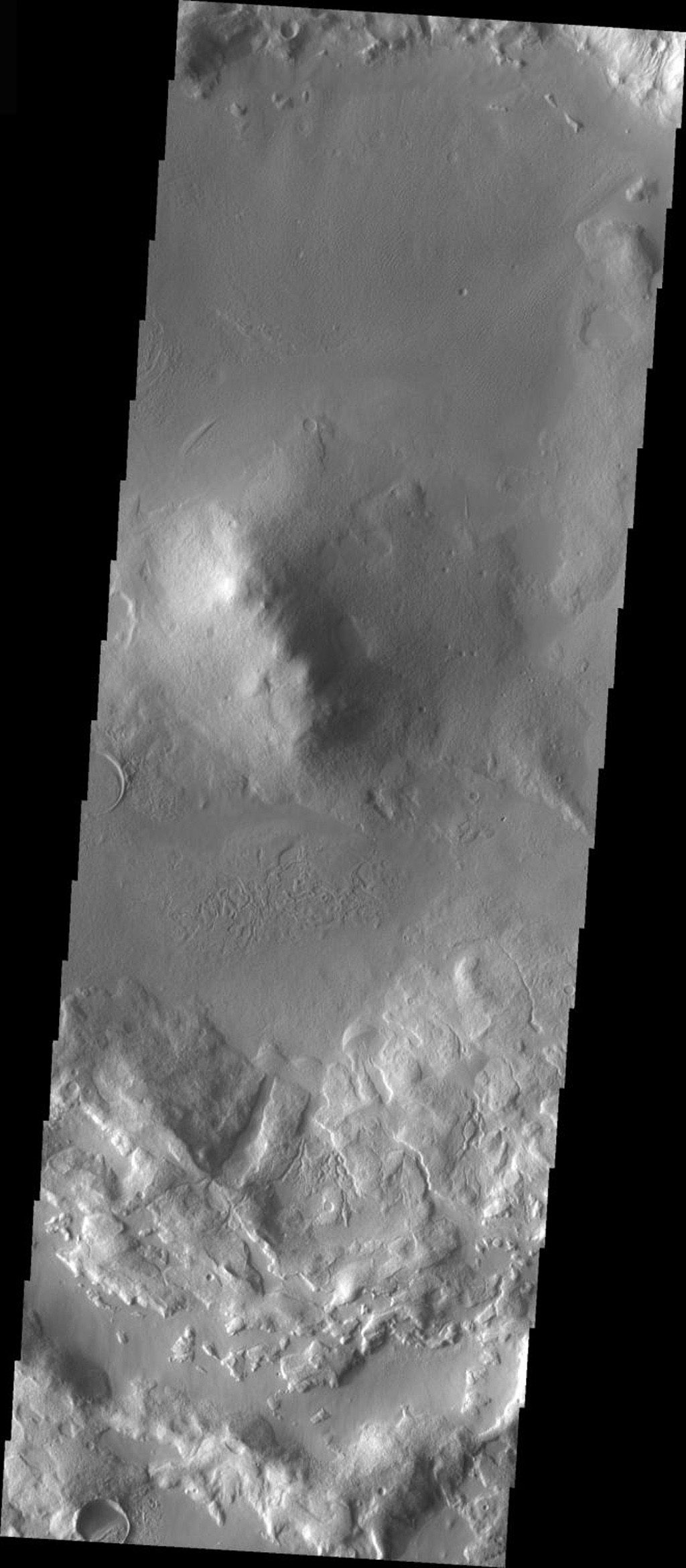 This image taken by NASA's Mars Odyssey shows Deuteronlius Mensae on Mars which contains a central peak in the middle of an older, flat-floored crater, infilled by sediment.
