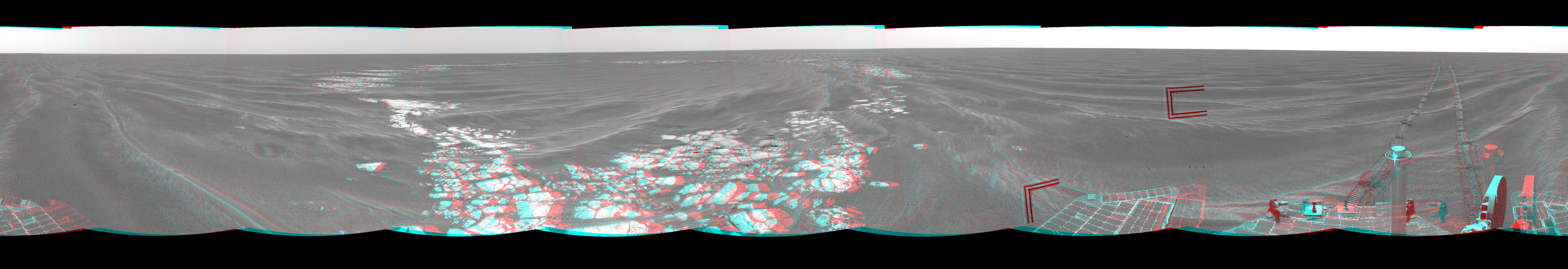 On Mar. 8, 2005, NASA's Mars Exploration Rover Opportunity drove 95 meters (312 feet) toward 'Vostok Crater' that sol before taking images. 3-D glasses are necessary to view this image.