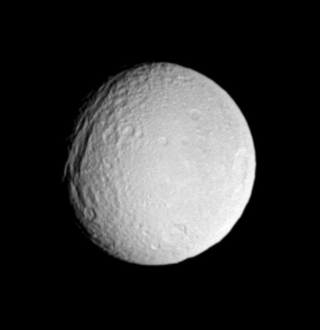 Saturn's icy moon Tethys displays a very old impact basin here, just southeast of its giant canyon system, Ithaca Chasma. This image was taken in visible light with NASA's Cassini spacecraft's narrow-angle camera on May 20, 2005.