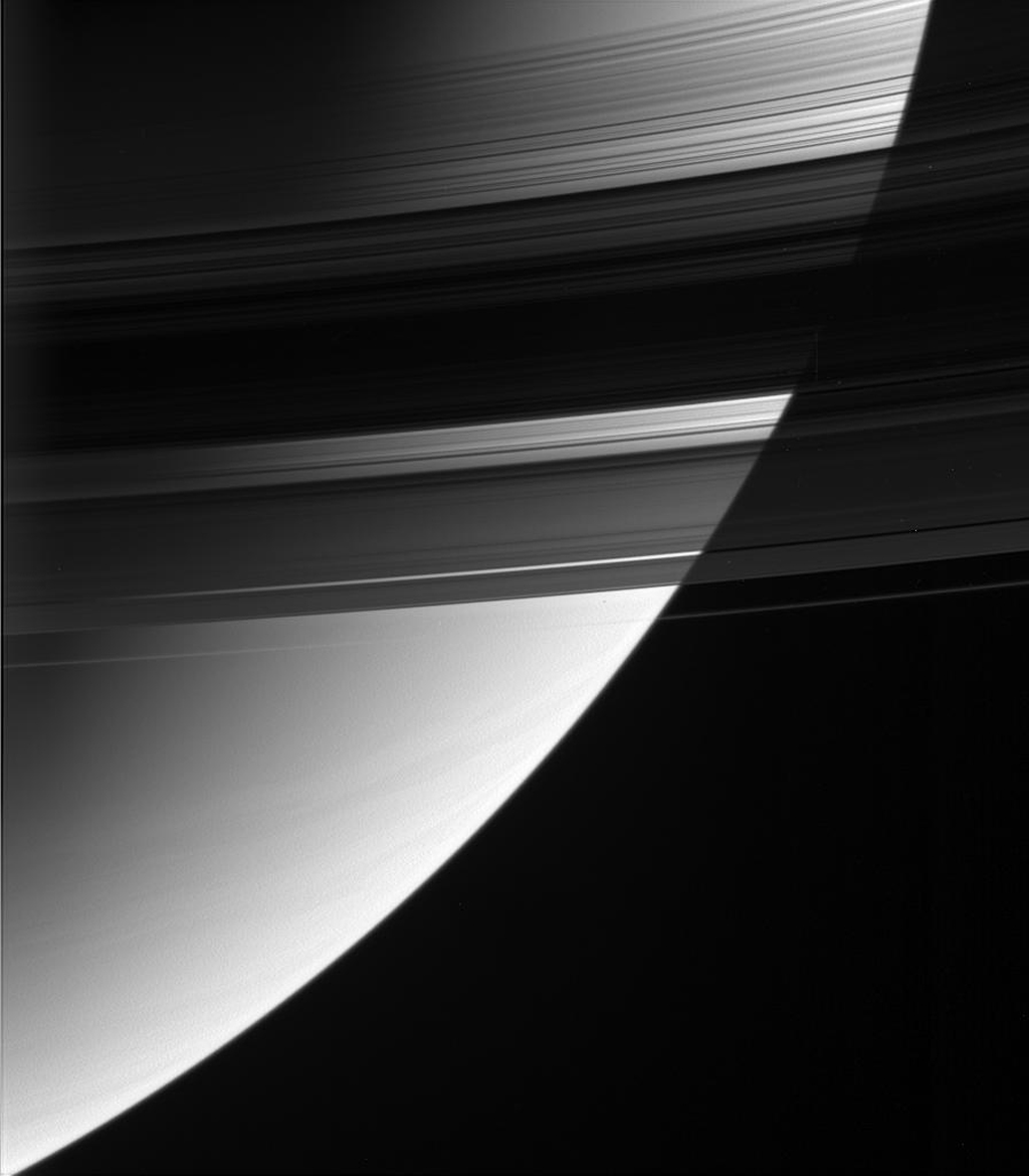 This magnificent view from NASA's Cassini spacecraft looks down upon, and partially through, Saturn's rings from their unlit side. The densest part of the rings occults the bright globe of Saturn.