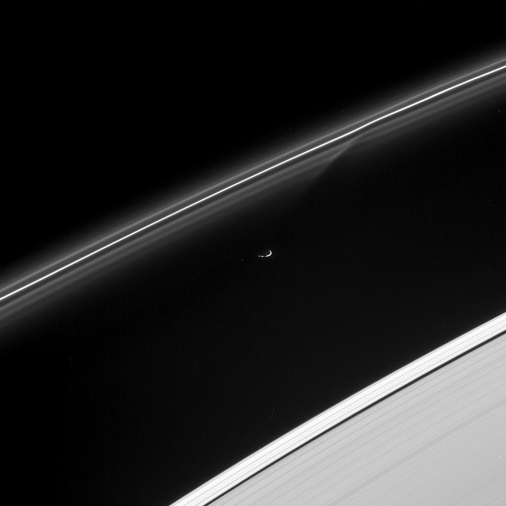 Prometheus has just passed and gravitationally disturbed some of the fine particulate material in the F ring, creating the sheared gap visible in the inner strands of the ring. The image was taken with NASA's Cassini spacecraft's narrow-angle camera.
