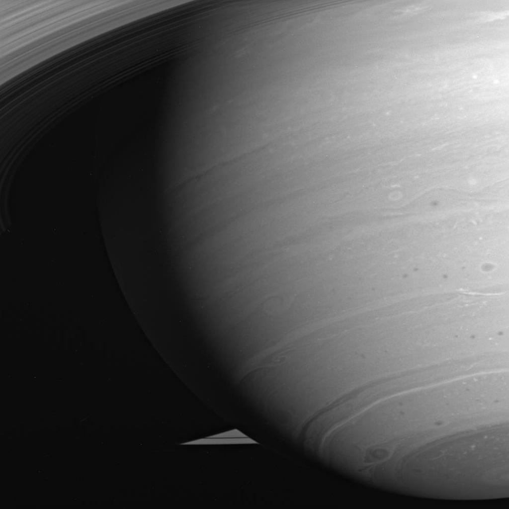 The latitude bands and swirling storms of Saturn, always intriguing to scientists, often are exquisitely beautiful as well. This image was taken in visible light with NASA's Cassini spacecraft's wide-angle camera on July 31, 2005.