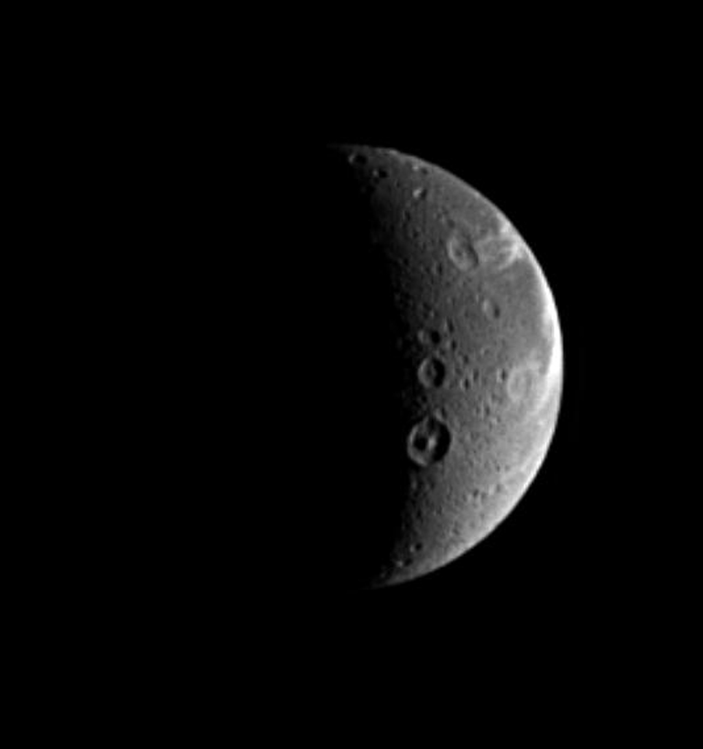 Naming features on other worlds, scientists like to follow themes, and Dione is no exception. Dione possesses numerous features with names from Virgil's 'Aeneid.' This image was taken in visible light with NASA's Cassini spacecraft taken on Aug. 25, 2005.
