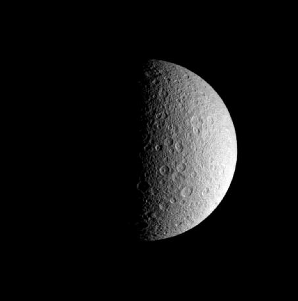 This half-lit view from NASA's Cassini spacecraft beautifully captures the ponderously old and cratered surface of Saturn's icy moon Rhea. Rhea is 1,528 kilometers (949 miles) across.