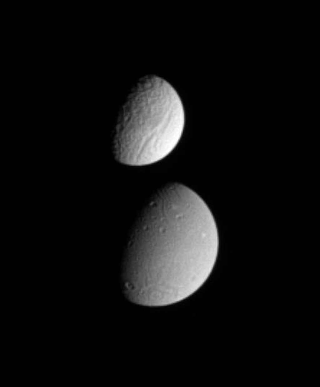 This brief movie catches Saturn's moon Tethys partially occulting the moon Dione. Images in this frame from a movie sequence were taken in visible light with NASA's Cassini spacecraft's narrow-angle camera on Sept. 11, 2005.