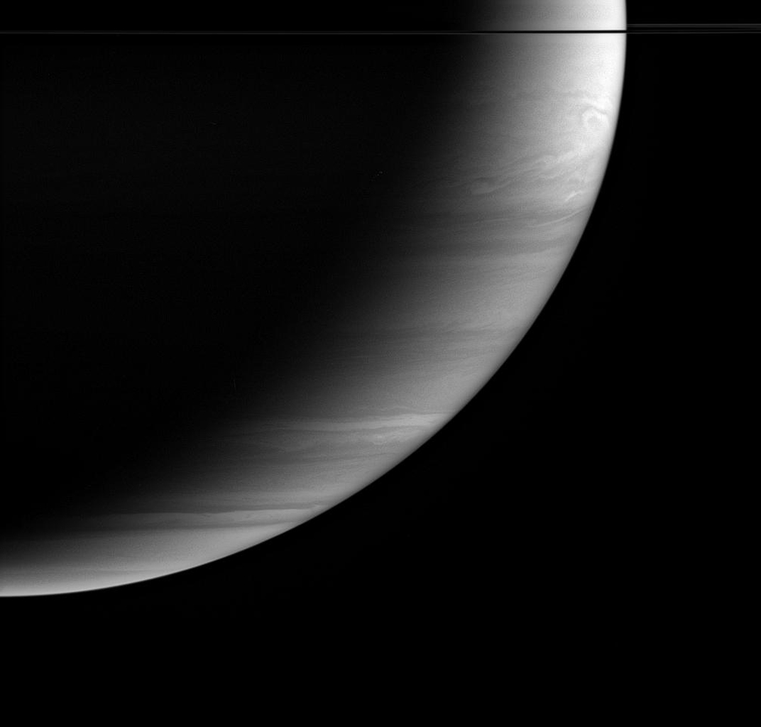 Feathery cloud bands fill Saturn's crescent in this image from NASA's Cassini spacecraft. Features in the atmosphere are visible all the way to the terminator, the boundary between night and day, where the Sun's rays are coming in almost horizontally.