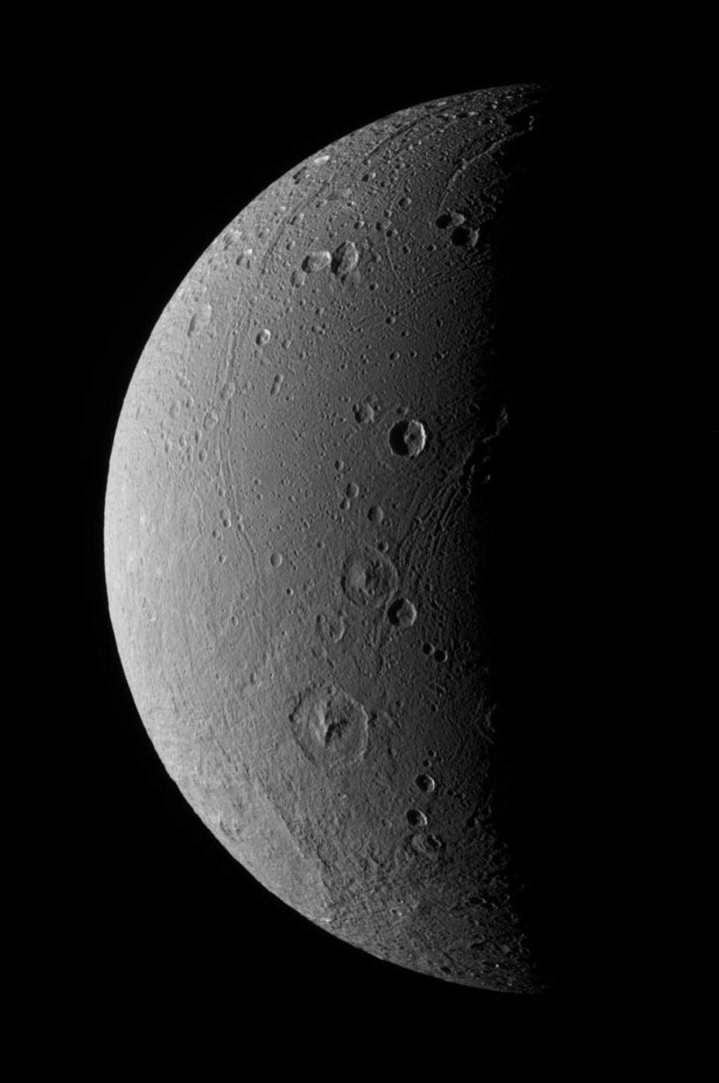 This view captured by NASA's Cassini spacecraft highlights tectonic faults and craters on Saturn's moon Dione, an icy world that has undoubtedly experienced geologic activity since its formation.