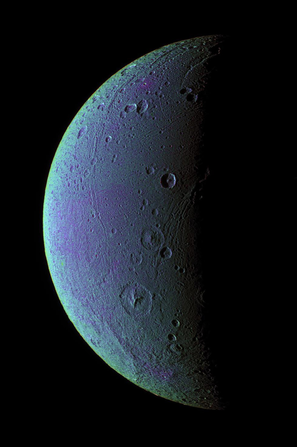 This view from NASA's Cassini spacecraft taken on Dec. 24, 2005, highlights tectonic faults and craters on Dione, an icy world that has undoubtedly experienced geologic activity since its formation.