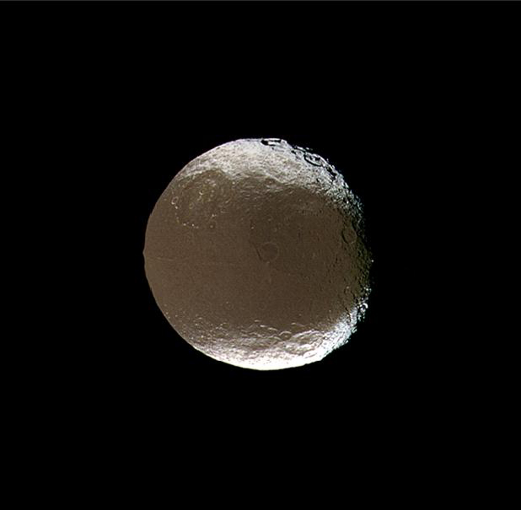 Saturn's two-faced moon tilts and rotates for NASA's Cassini spacecraft in this mesmerizing image acquired during the spacecraft's close encounter with Iapetus on Nov. 12, 2005.