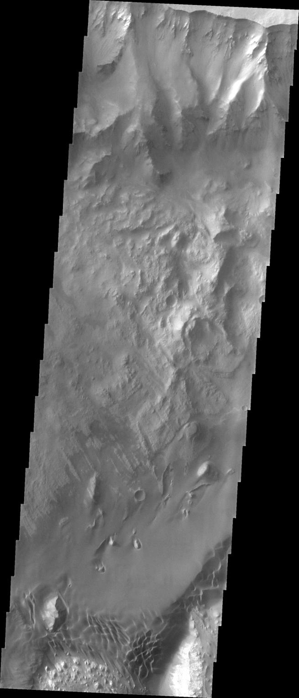 This image from NASA's Mars Odyssey spacecraft is of a sand sheet on Mars in the Ganges Chasma portion of Valles Marineris. Sand seas on Earth are often called ergs, an Arabic name for dune field. In this image, dunes are coalescing into a sand sheet.