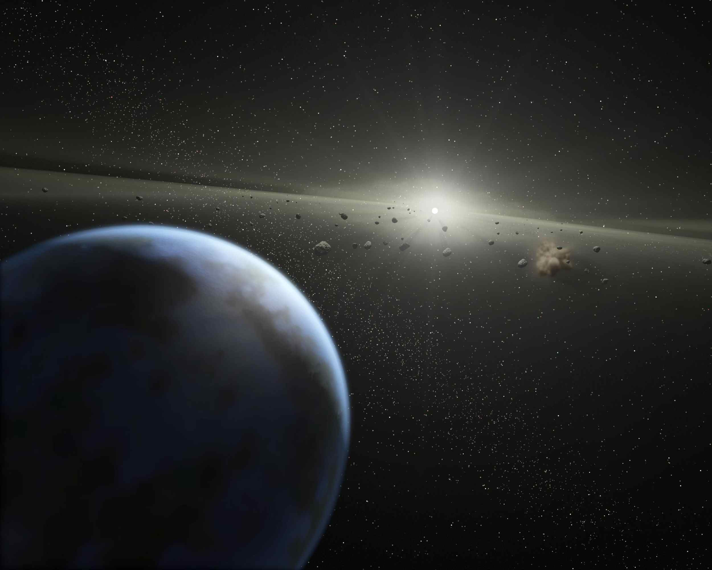 Evidence for this possible belt was discovered by NASA's Spitzer Space Telescope when it spotted warm dust around the star, presumably from asteroids smashing together. This is an artist's concept.