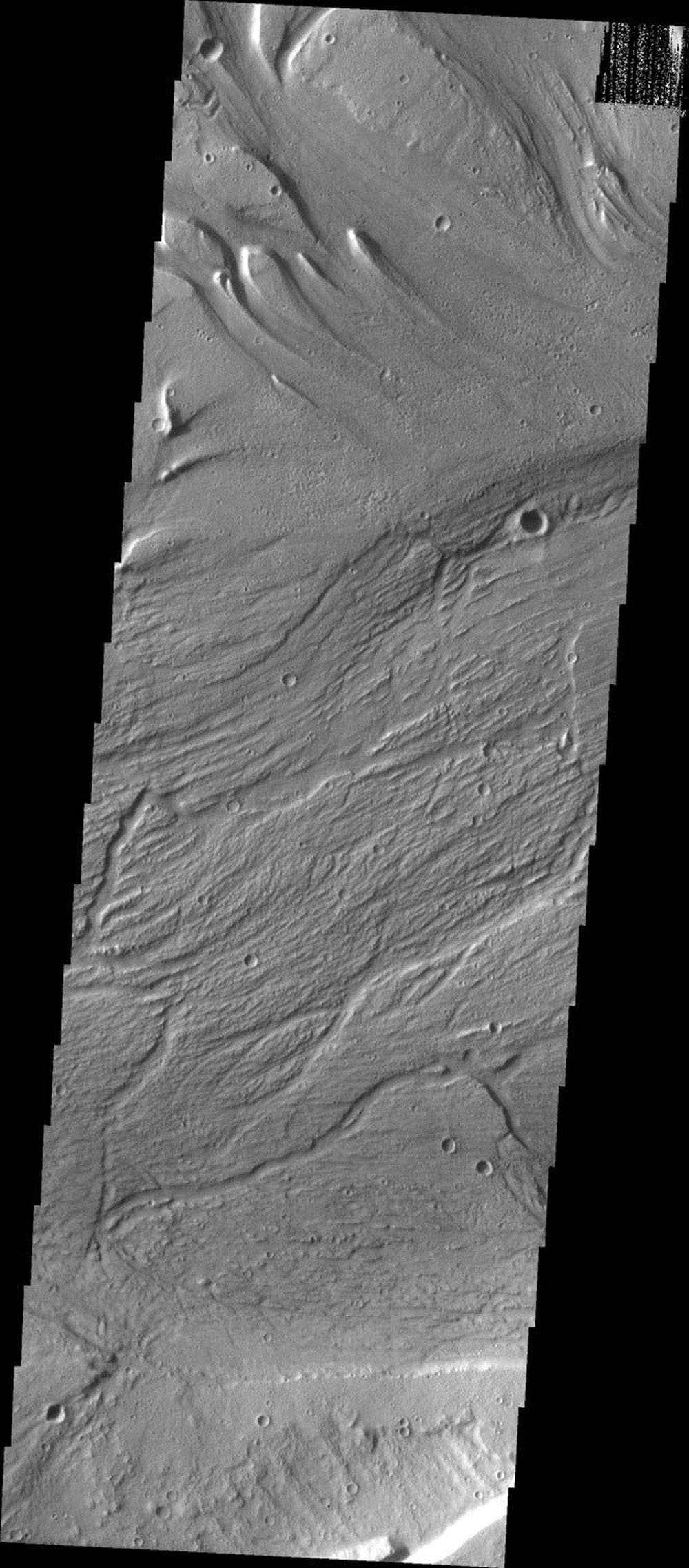 This image from NASA's Mars Odyssey spacecraft shows the Kasei Vallis complex on Mars which contains two main channels that run east-west across Tempe Terra and empty into Chryse Planitia.