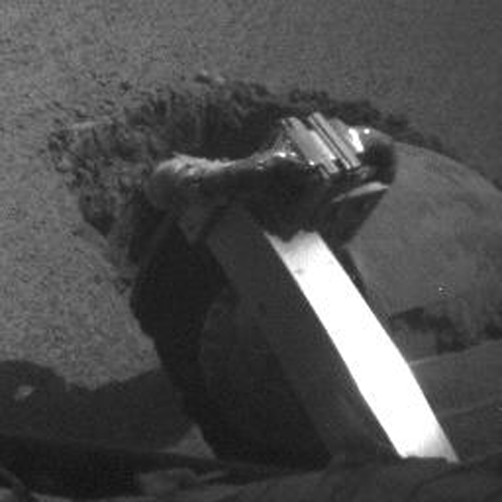 The left rear wheel of NASA's Mars Exploration Rover Opportunity made slow but steady progress through soft dune material in this image taken by the rover's front hazard identification camera over a period of several days.