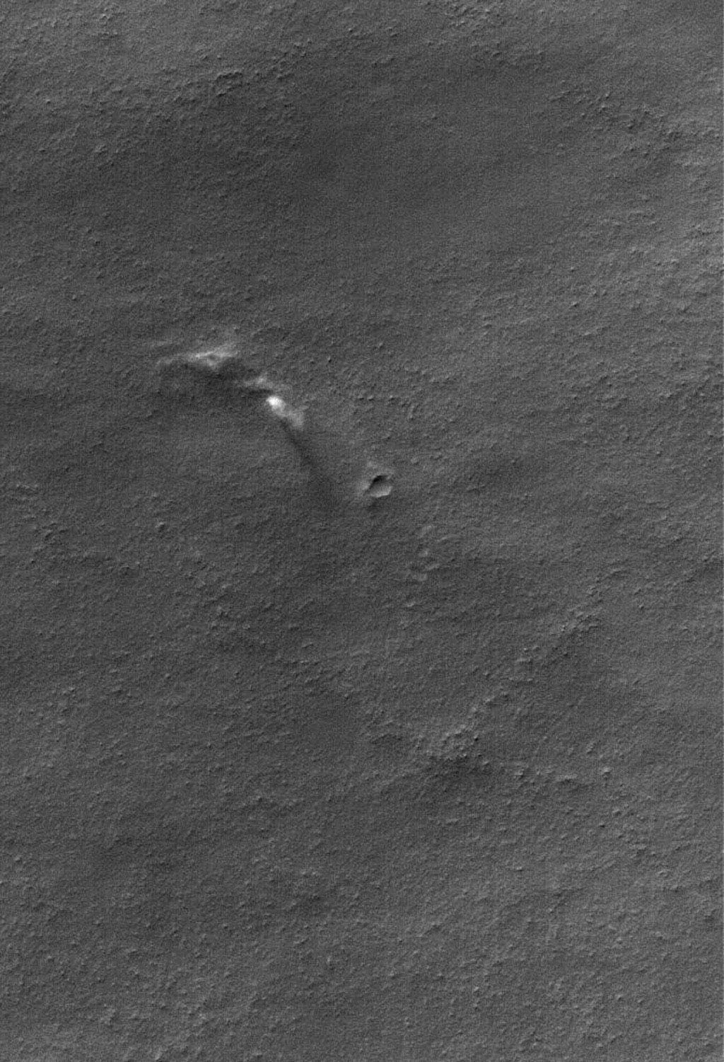 This image from NASA's Mars Global Surveyor shows dust plumes created by gusting winds on a plain southwest of Argyre Planitia.
