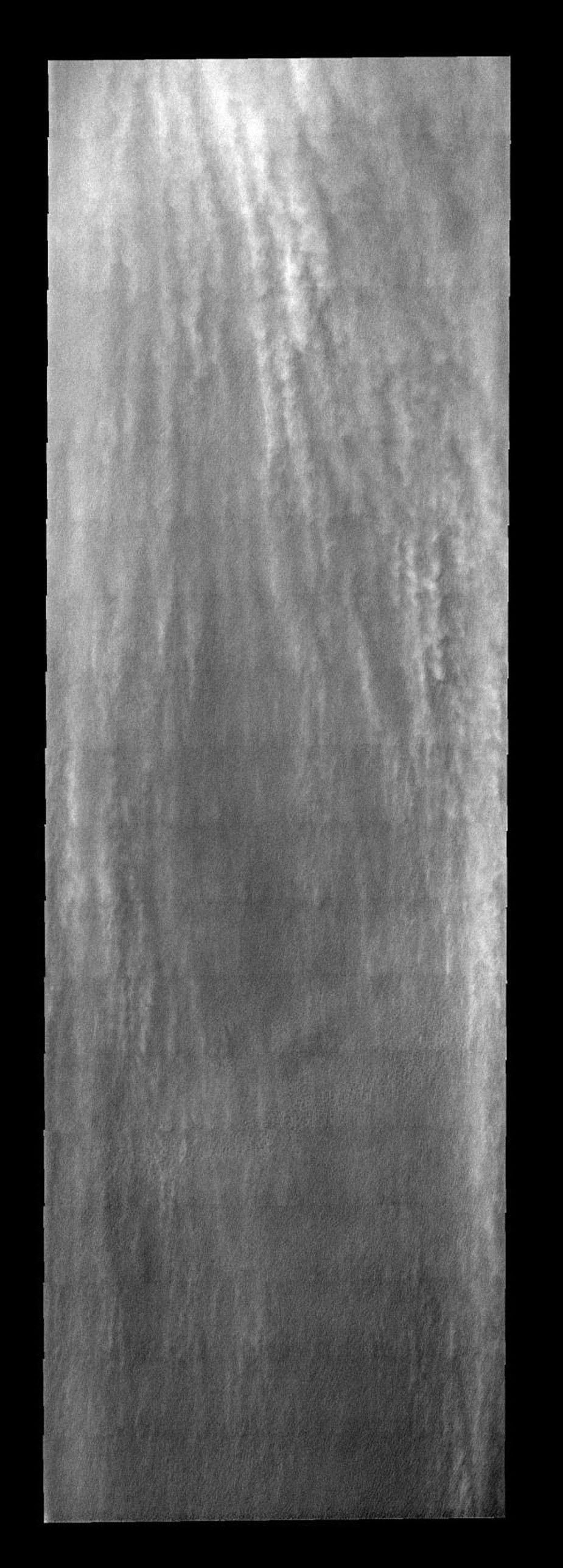 These linear clouds are part of a large storm front that occurred near Mars' south pole during late summer as seen by NASA's 2001 Mars Odyssey.