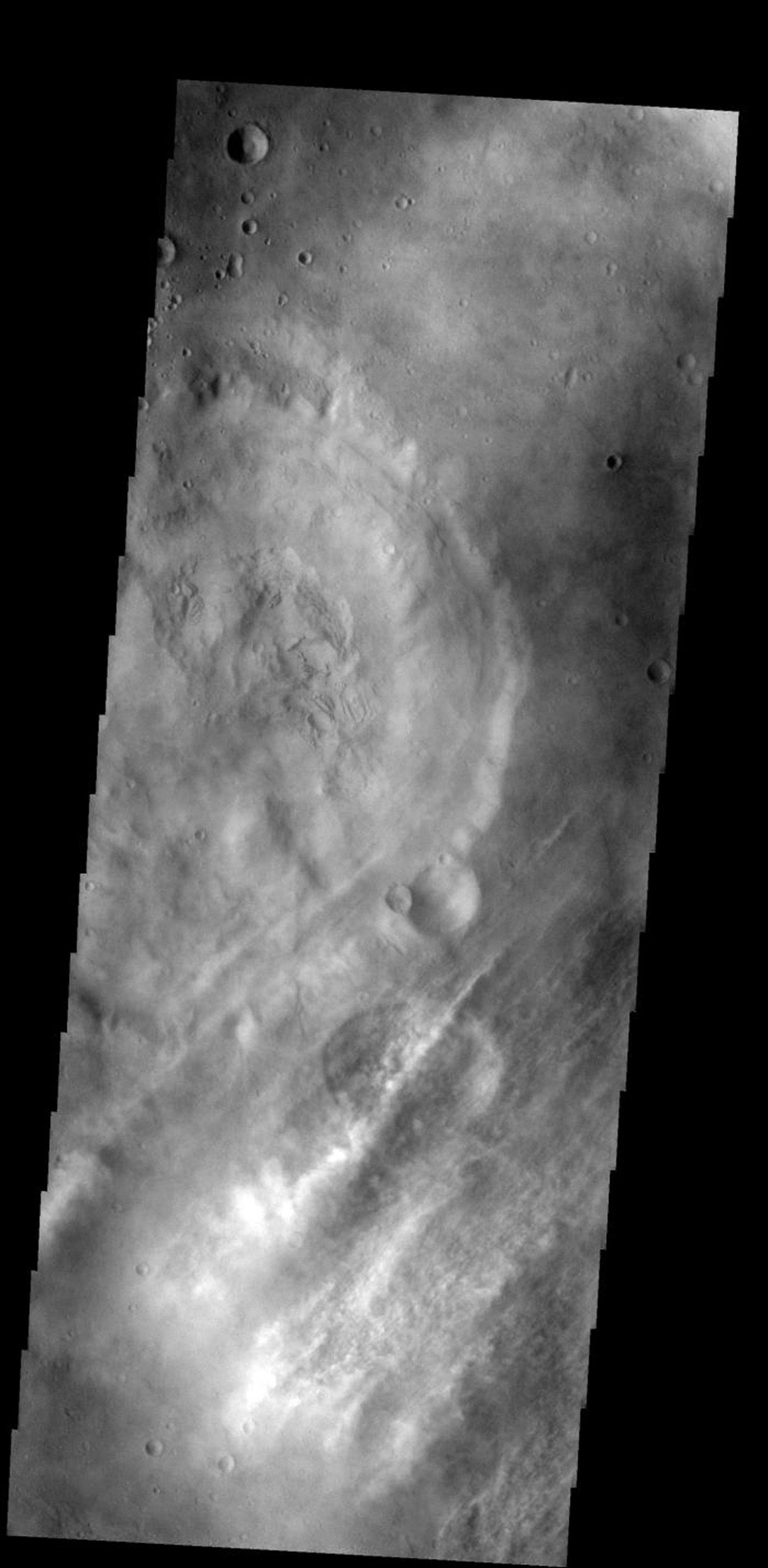 These streamers of clouds cross over a small crater on Mars without deflection as seen by NASA's 2001 Mars Odyssey spacecraft.