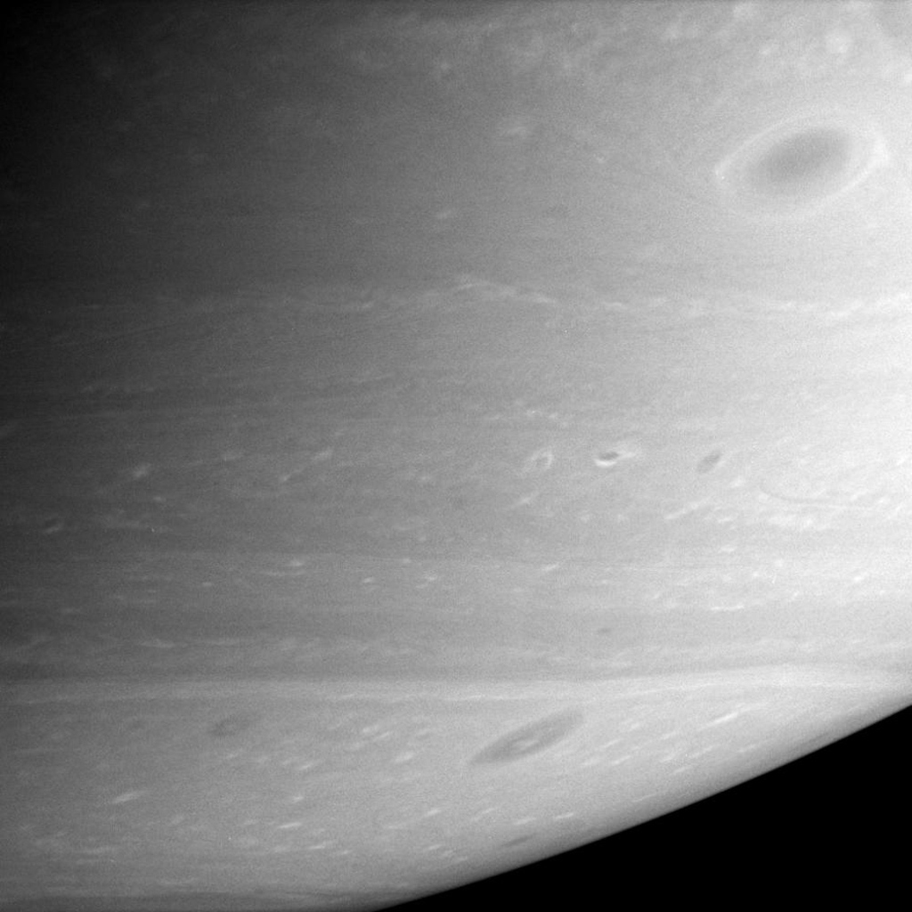 Saturn's atmosphere comes alive with a multitude of dark vortices swirling through the southern hemisphere. This image was taken with NASA's Cassini spacecraft's narrow-angle camera on Feb. 16, 2006.