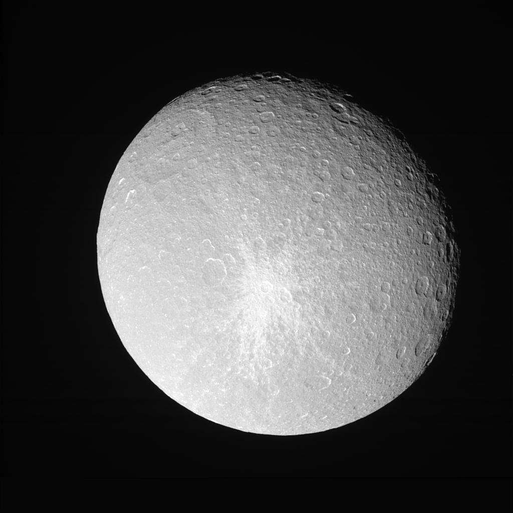 Rhea shows off her bright, fresh-looking impact crater in this view from NASA's Cassini view taken during a close approach.