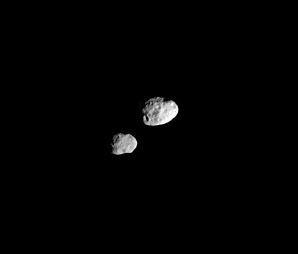 In their orbital ballet, Janus and Epimetheus swap positions every four years -- one moon moving closer to Saturn, the other moving farther away. This is image is from NASA's Cassini spacecraft.