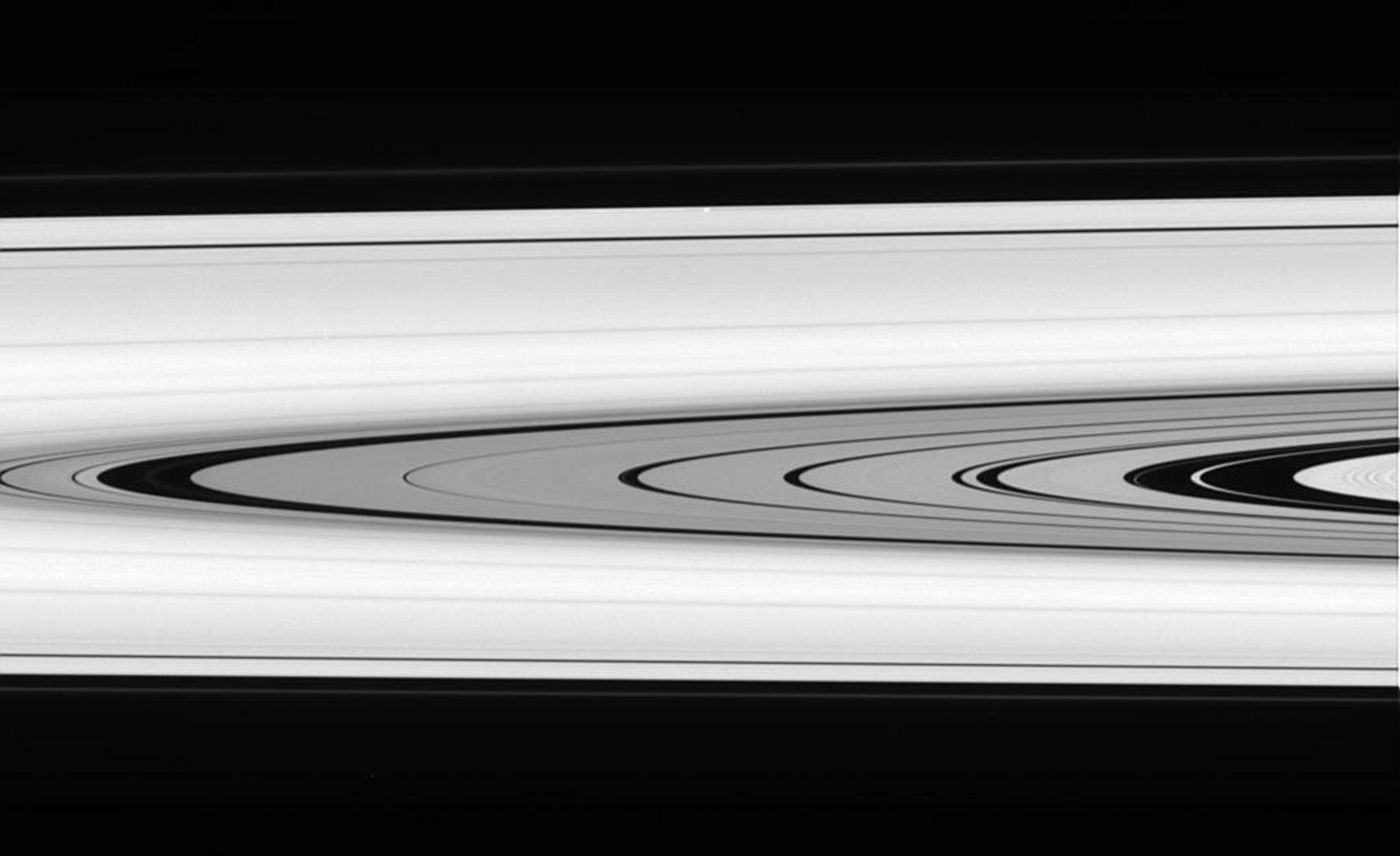 This splendid view from NASA's Cassini spacecraft offers a detailed look at the faint rings within the Cassini Division as well as a rare glimpse of the Keeler gap moon, Daphnis.