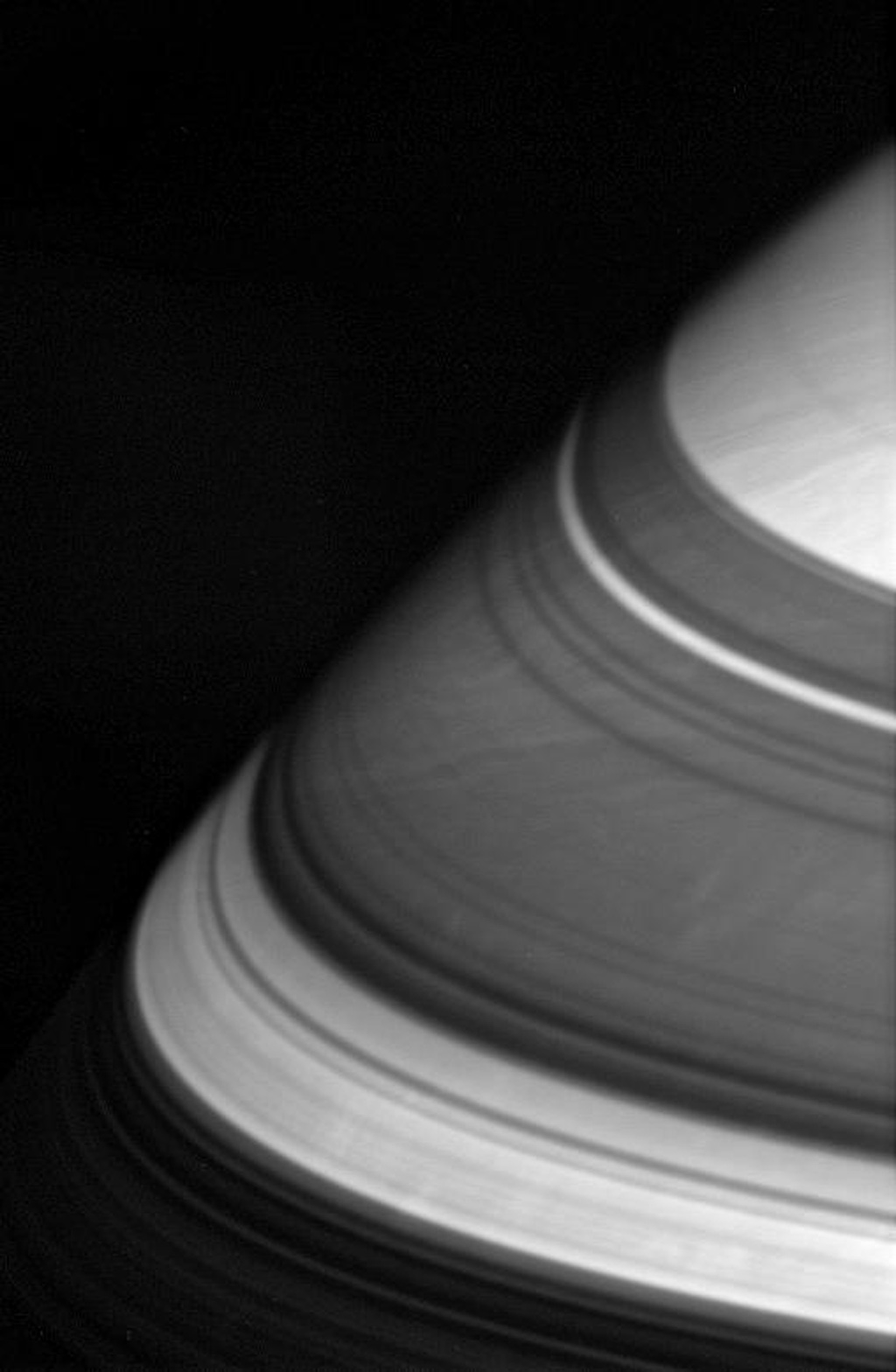 The dark shadows that drape Saturn's northern latitudes are split by three familiar bright gaps as seen by NASA's Cassini spacecraft.