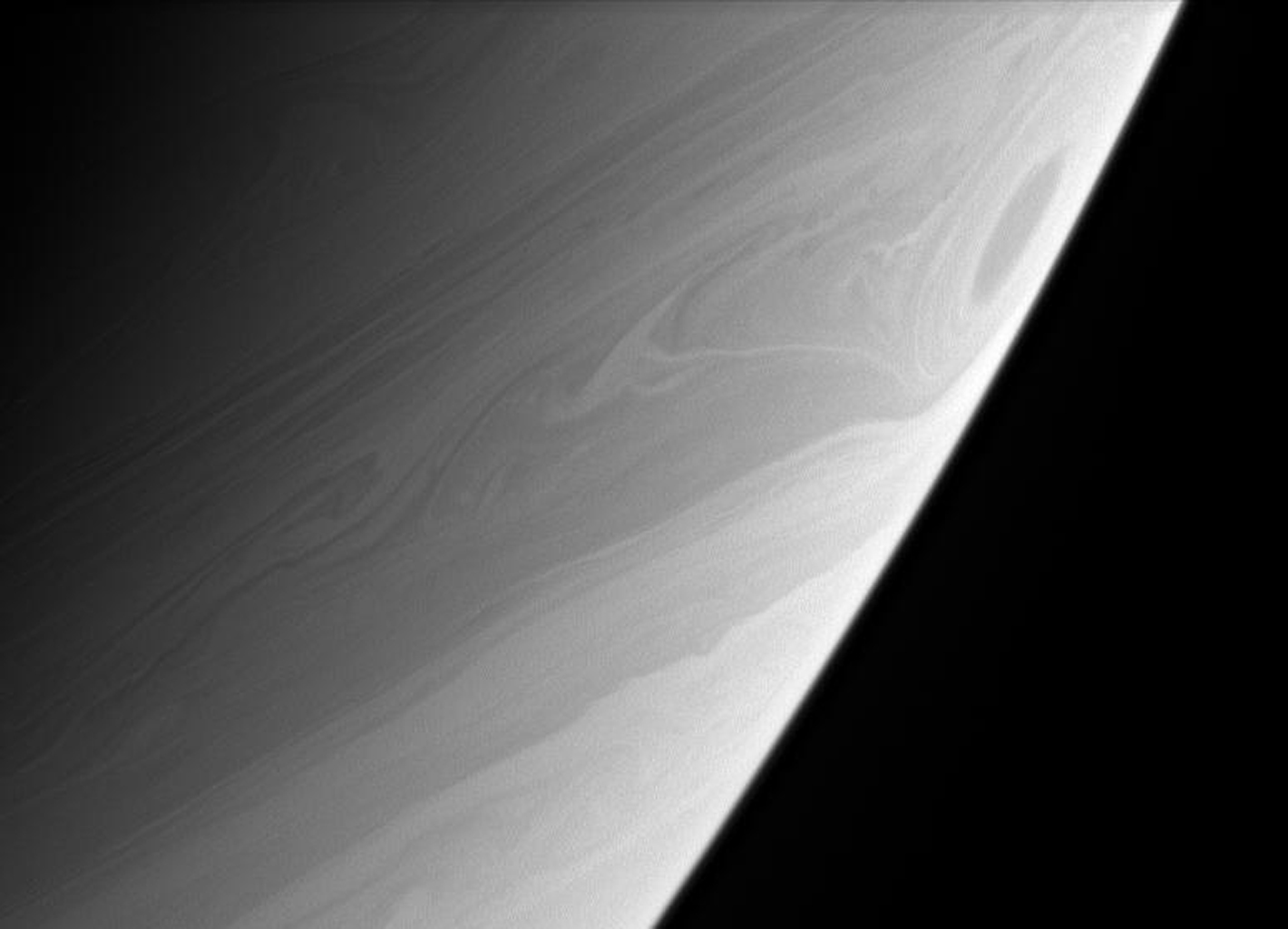 A great vortex rolls through high southern latitudes on Saturn, whirling twisted contours into the clouds. This image was taken with NASA's Cassini spacecraft's narrow-angle camera at a distance of approximately 2.8 million kilometers from Saturn.