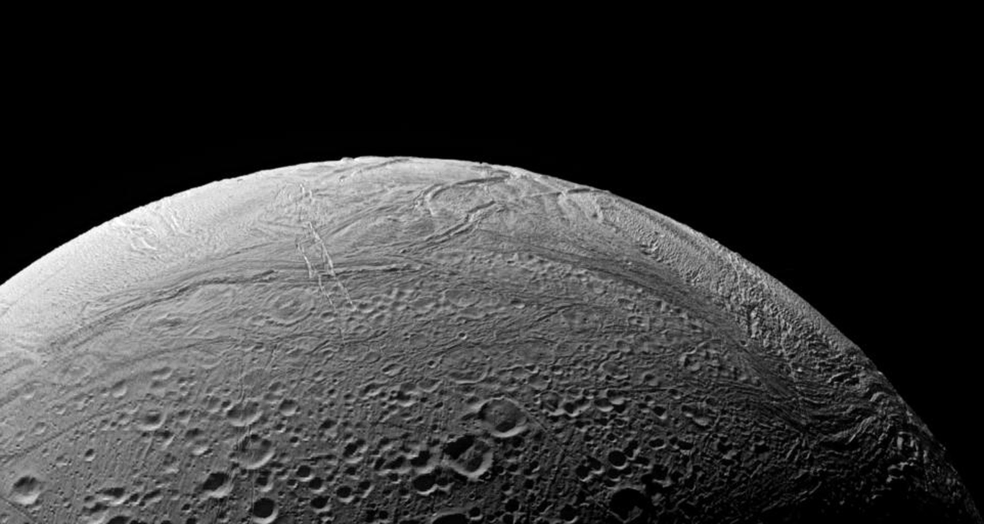 The wrinkled border of Enceladus' south polar region snakes across this view from NASA's Cassini spacecraft, separating fresher, younger terrain from more ancient, cratered provinces.