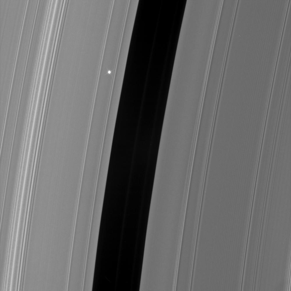 As NASA's Cassini watches the rings pass in front of the bright red giant star Aldebaran, the star's light fluctuates, providing information about the concentrations of ring particles within the various radial features in the rings.