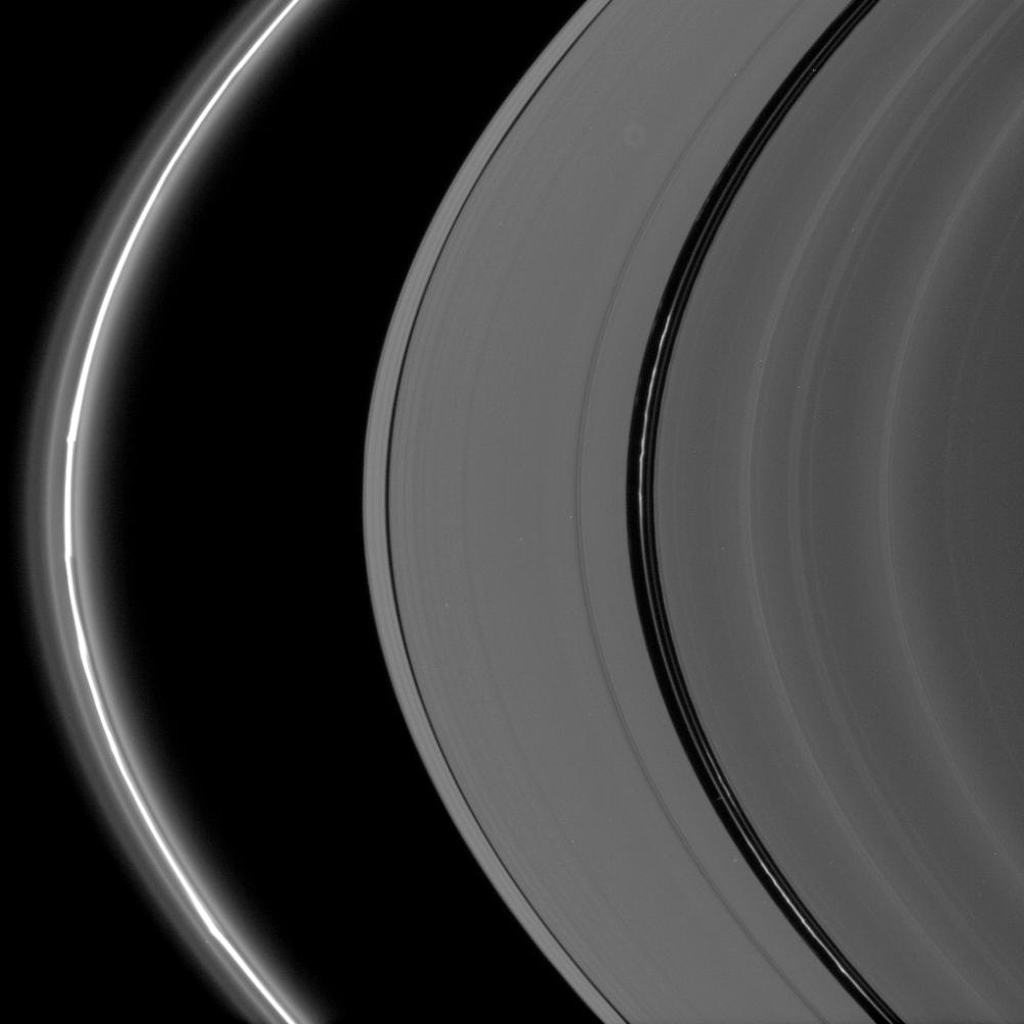 Bright, kinked ringlets fill the Encke Gap, while the F ring glows brilliantly and displays its signature knots and flanking, diffuse ringlets as seen by NASA's Cassini spacecraft.