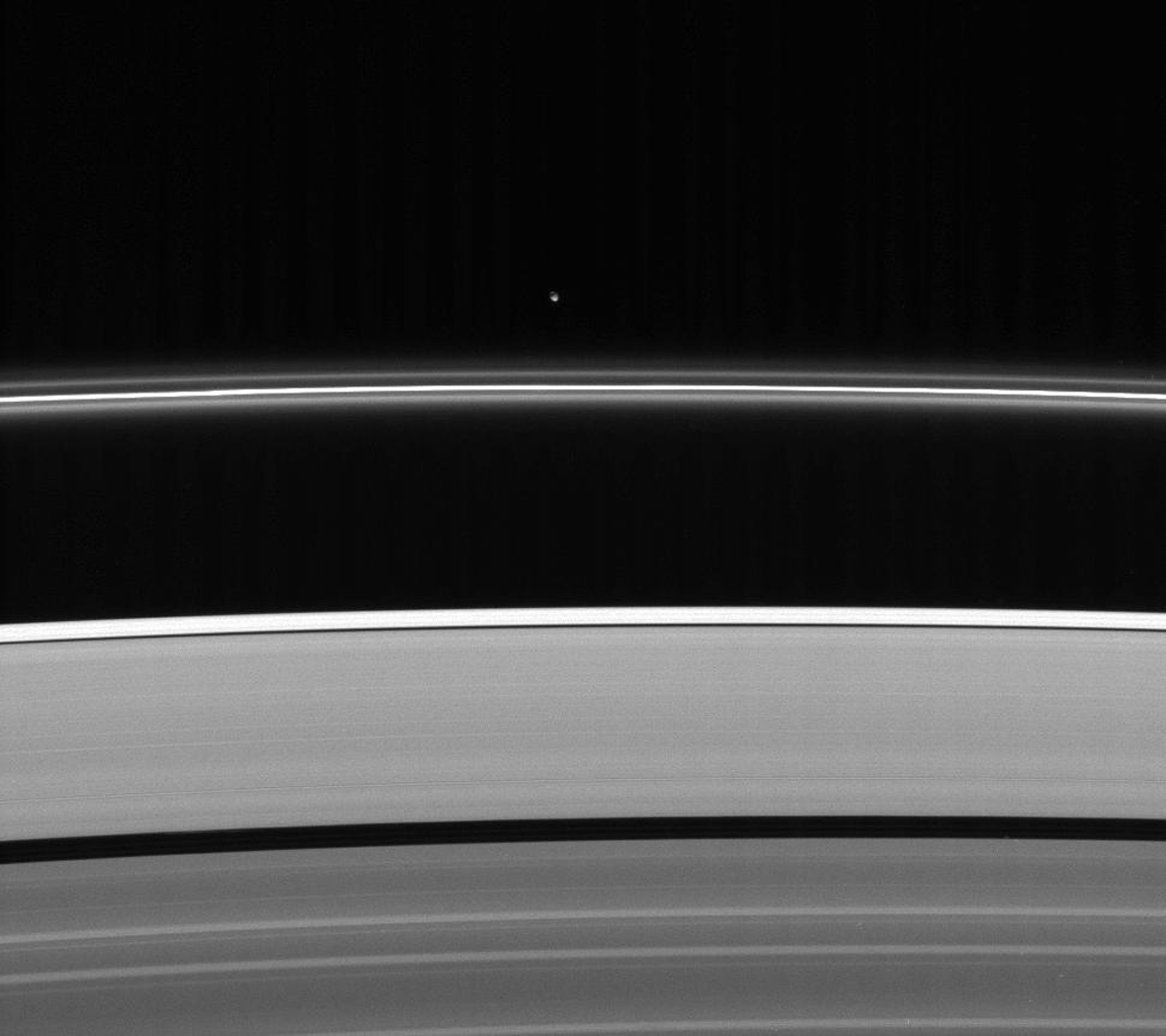 Less intrusive than her sibling shepherd moon, Pandora nonetheless provides a gravitational influence that helps confine and perturb the F ring's shape in this image from NASA's Cassini spacecraft.