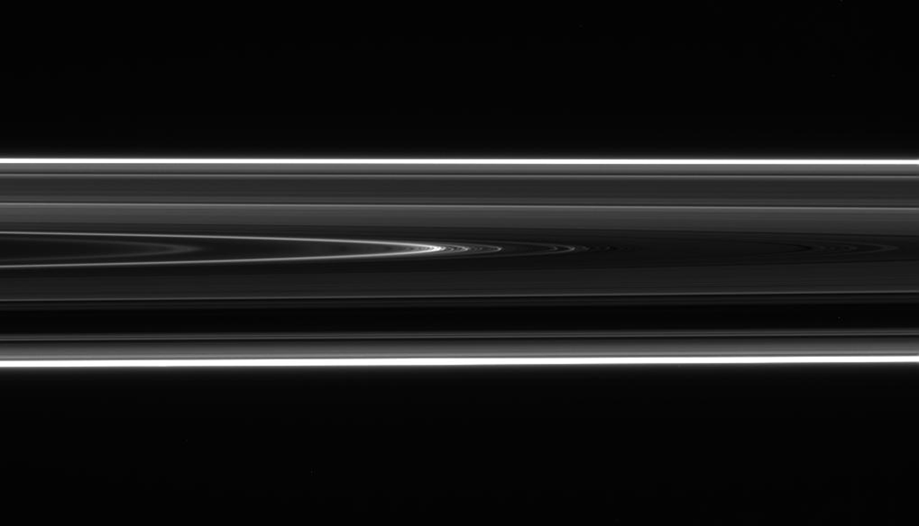 Saturn's D ring--the innermost of the planet's rings -- sports an intriguing structure that appears to be a wavy, or 'vertically corrugated,' spiral as seen by NASA's Cassini spacecraft.