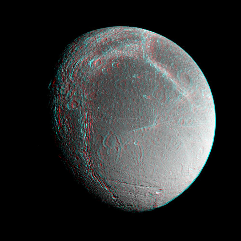 Saturn's moon Dione floats in the dark sky before NASA's Cassini spacecraft. Images taken from slightly different directions allow construction of stereo views, helpful in interpreting the complex topography of Saturn's moons. 3D glasses are necessary.