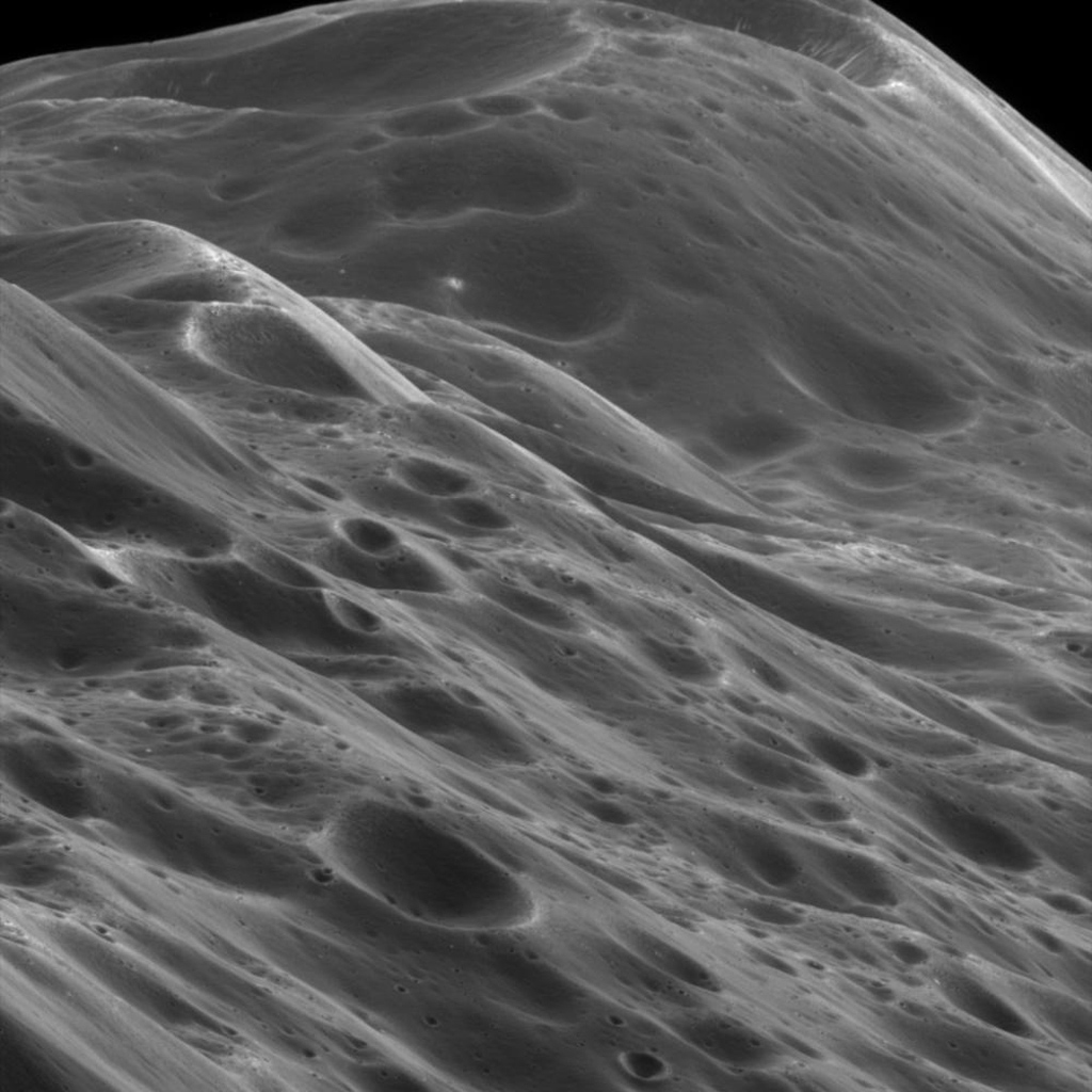 The image, taken on Sept. 10, 2007, with NASA's Cassini spacecraft, shows mountainous terrain that reaches about 10 kilometers (6 miles) high along the unique equatorial ridge of Iapetus.