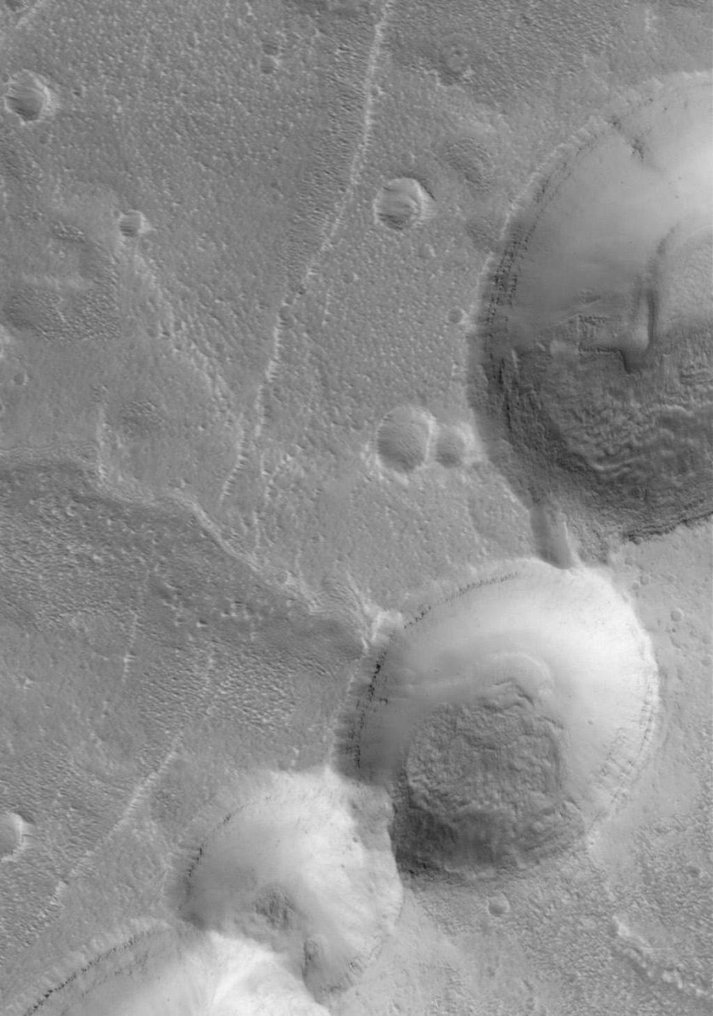 This NASA Mars Global Surveyor image shows partially-filled collapse pits on the eastern flank of Alba Patera, a large volcano in northern Tharsis.