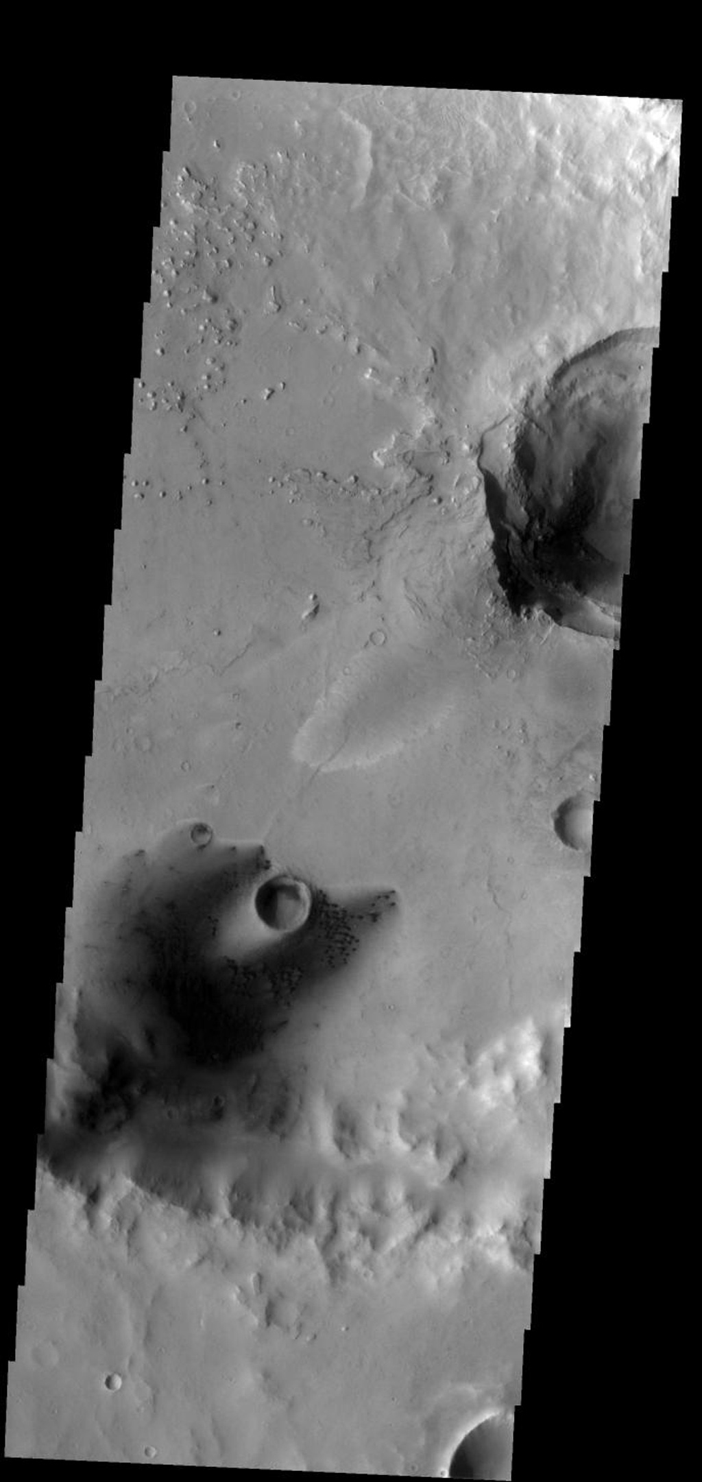 These small dunes occur on the floor of an unnamed crater in Arabia Terra on Mars as seen by NASA's 2001 Mars Odyssey spacecraft.
