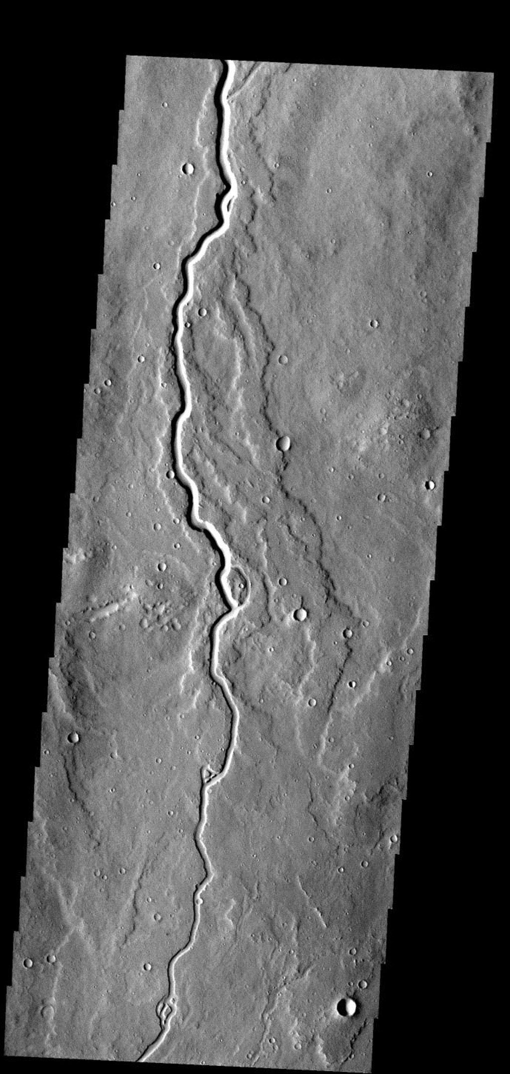 This lava channel is part of the Elysium Mons flows on Mars as seen by NASA's 2001 Mars Odyssey spacecraft.