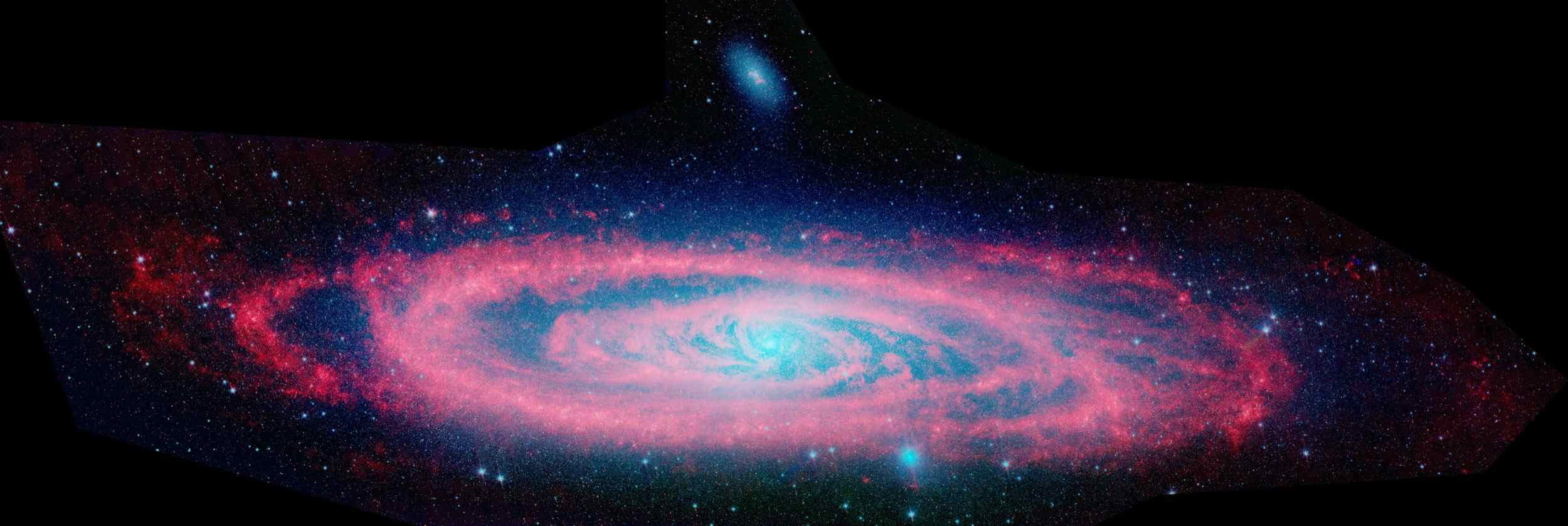 This image shows the Andromeda galaxy, first as seen in visible light by the National Optical Astronomy Observatory, then as seen in infrared by NASA's Spitzer Space Telescope.