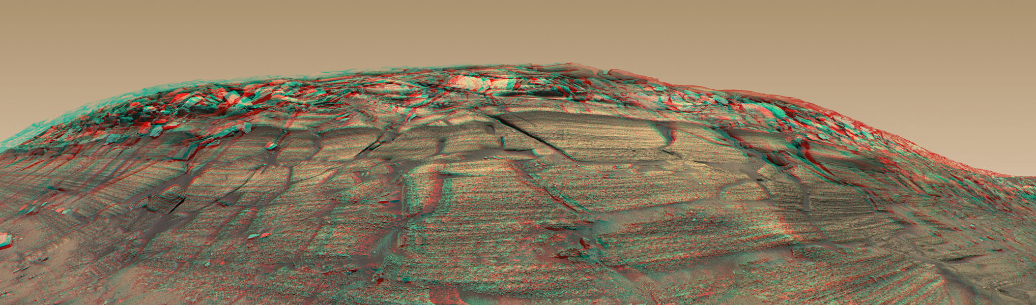 NASA's Mars Exploration Rover Opportunity captured a sweeping stereo image of 'Burns Cliff' after driving right to the base of this southeastern portion of the inner wall of 'Endurance Crater' in November 2004. 3D glasses are necessary to view this image.