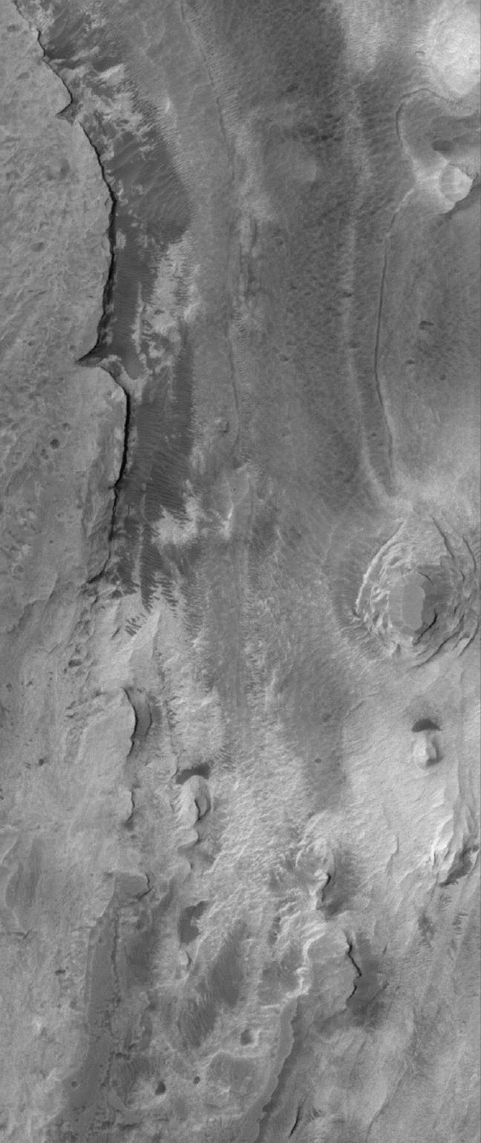 NASA's Mars Global Surveyor shows layered, light-toned exposures of probable sedimentary rock in Iani Chaos on Mars.