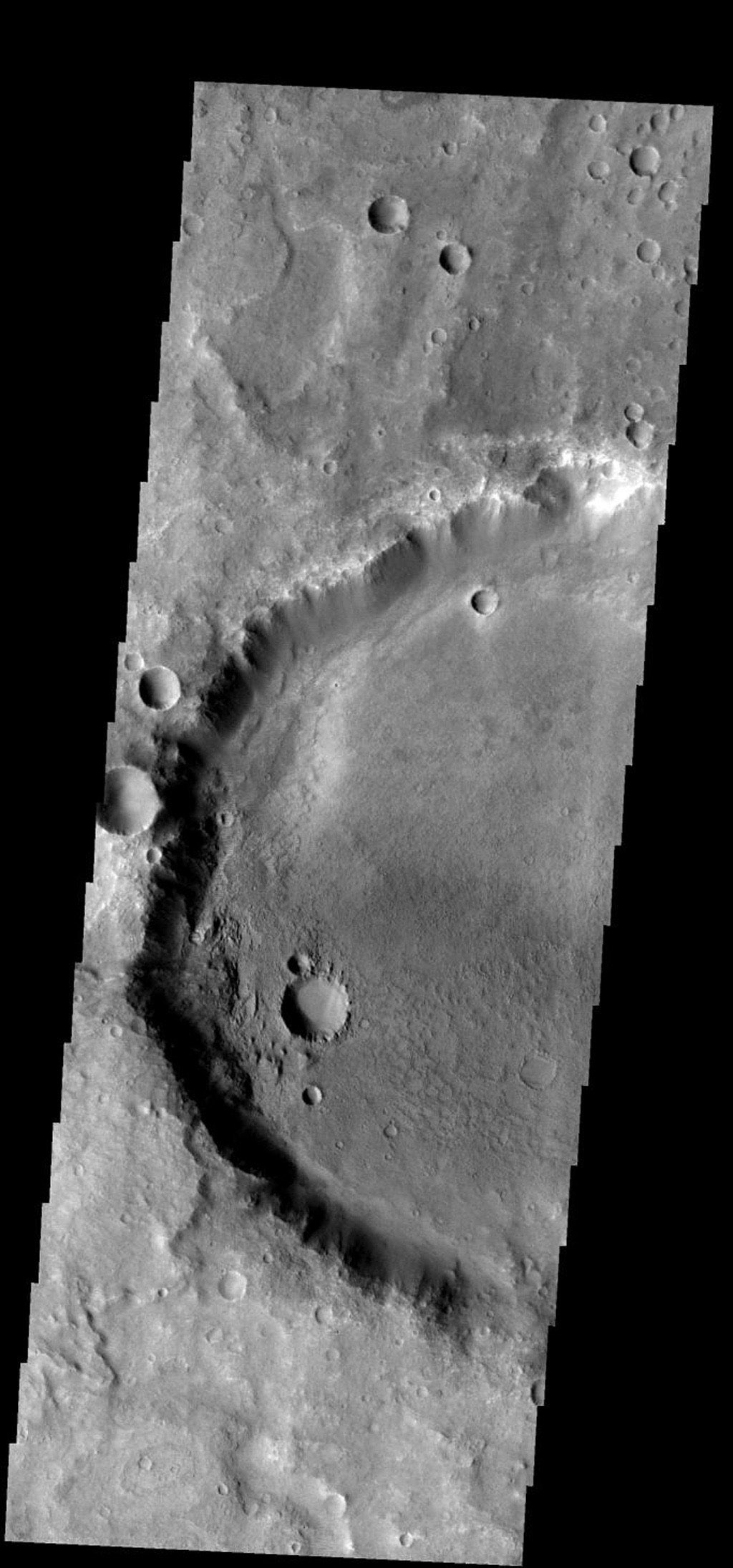 The floor of this crater near its southwestern rim is rougher that the rest of the crater floor. Some process of change is working only in this area on Mars as seen by NASA's Mars Odyssey spacecraft.