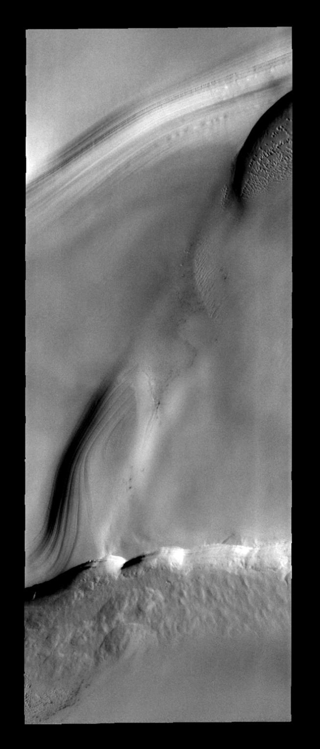 This image of the north polar layered deposits also contains sand dunes on Mars as seen by NASA's Mars Odyssey spacecraft.