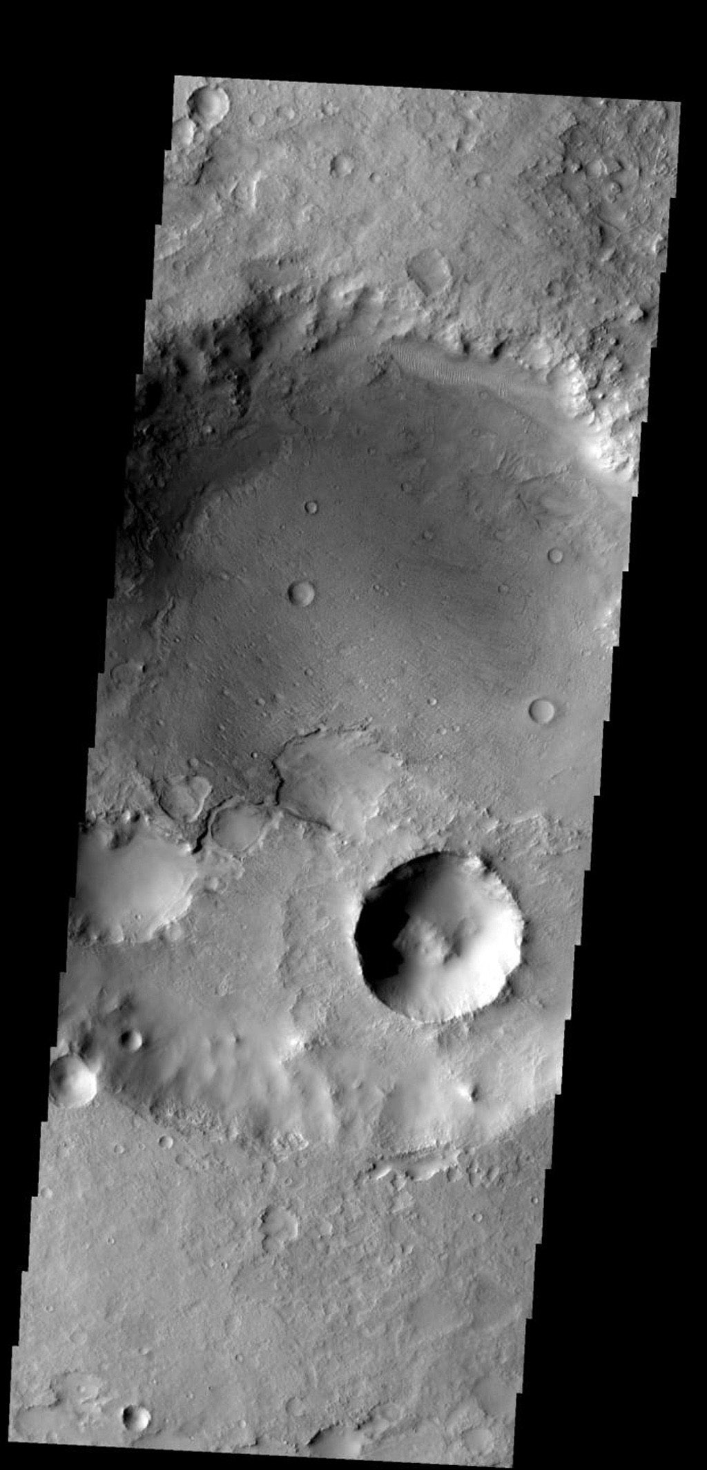 This crater, on the northern margin of Syrtis Major, has been filled with material that is now being removed on Mars as seen by NASA's Mars Odyssey spacecraft.