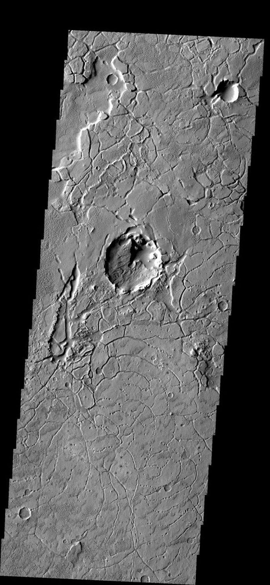 The arcuate fractures seen in this image are common along the highland/lowland boundary on Mars as seen by NASA's Mars Odyssey spacecraft.