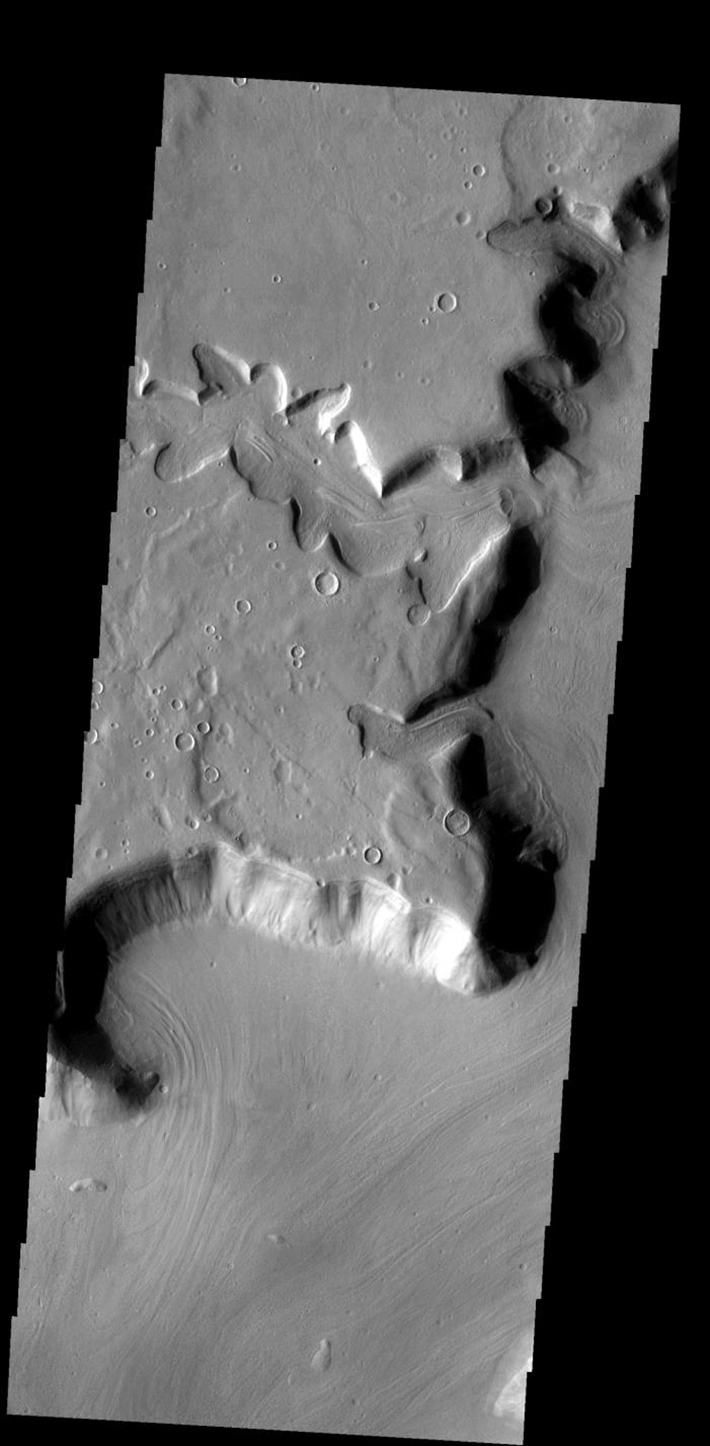 This interesting tributary channel is located in the Deuteronilus region of Mars on Mars as seen by NASA's Mars Odyssey spacecraft.