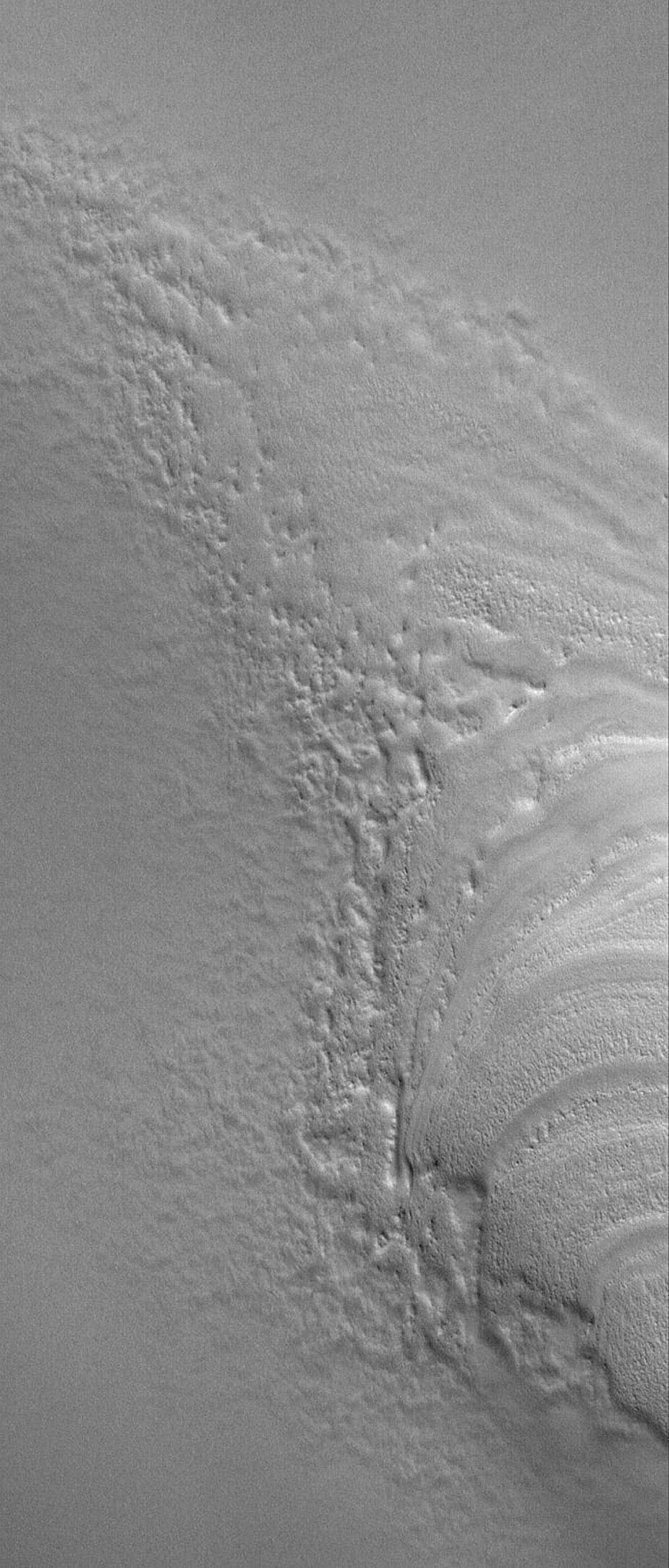 This image from NASA's Mars Global Surveyor shows the termination (end) of a group of layers in the north polar region of Mars, where they have been buried by younger, smoother-surfaced material.