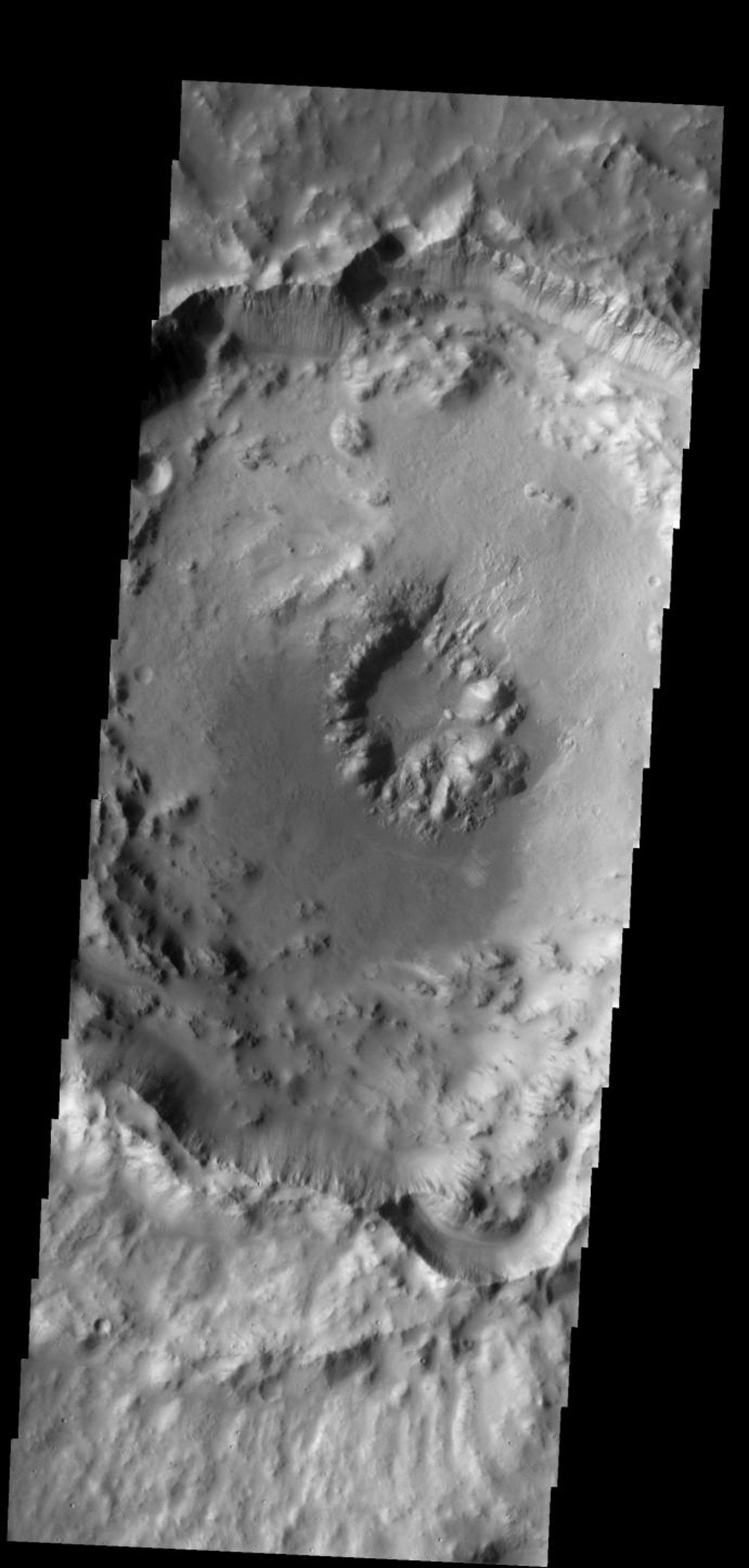 This crater with a central pit is located in Arabia Terra on Mars as seen by NASA's Mars Odyssey spacecraft.