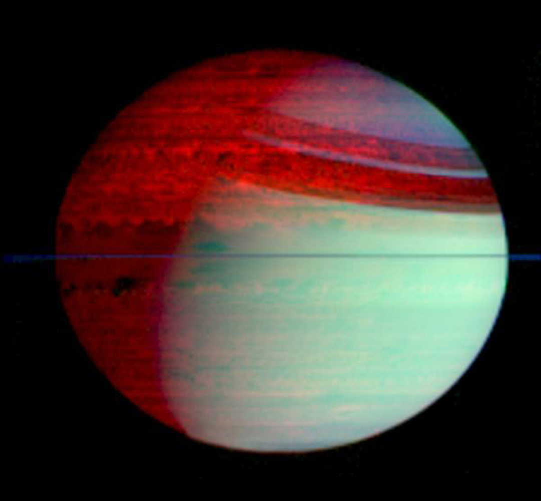 This false-color mosaic of Saturn shows deep-level clouds silhouetted against Saturn's glowing interior. This image was made with data from NASA's Cassini visual and infrared mapping spectrometer.